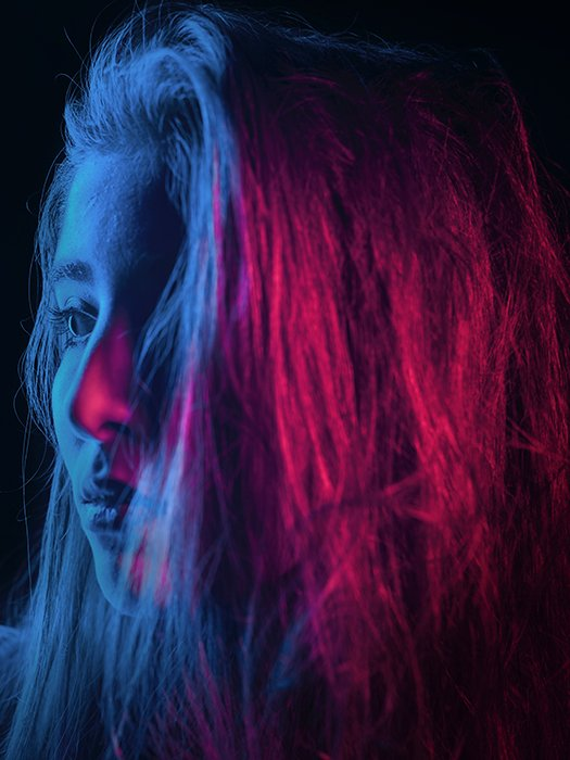 Atmospheric neon portrait of a female model shot using neon photography
