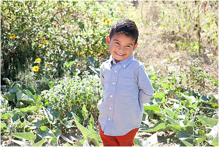 Sweet child photography portrait of a young boy posing outdoors
