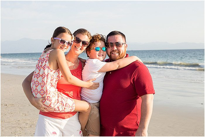 Relaxed portrait of a family posing on a beach - how to photograph people