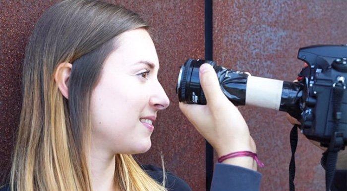 Image of a photographer using a DIY macro lens to shoot a closeup of a women's eyes