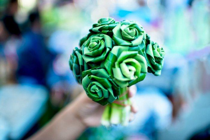 a hand holding a paper bouquet