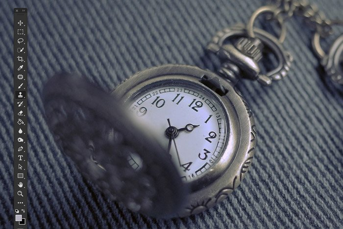 A close up product photography shot of a pocket watch - cleaning the image