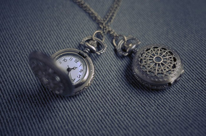 A close up product photography shot of a pocket watch