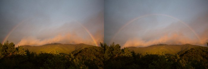 Part of a rainbow in front of an impressive landscape - pictures of rainbows