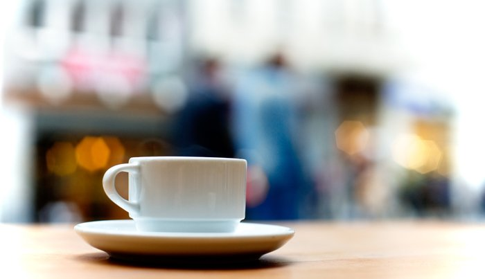 A close up of a coffee cup on a table - stock photography tips