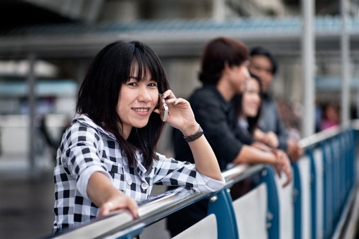A stock photography portrait of a female model talking on the phone