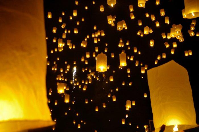 Many sky lanterns lighting at night - stock photography style