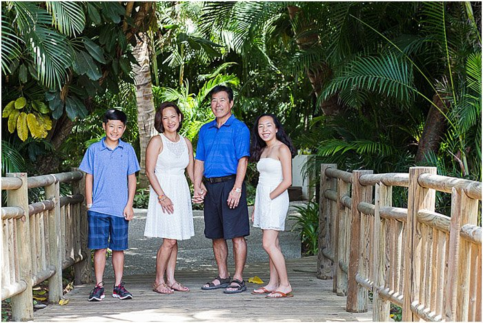 A family of four posing outdoors - take good photos of people