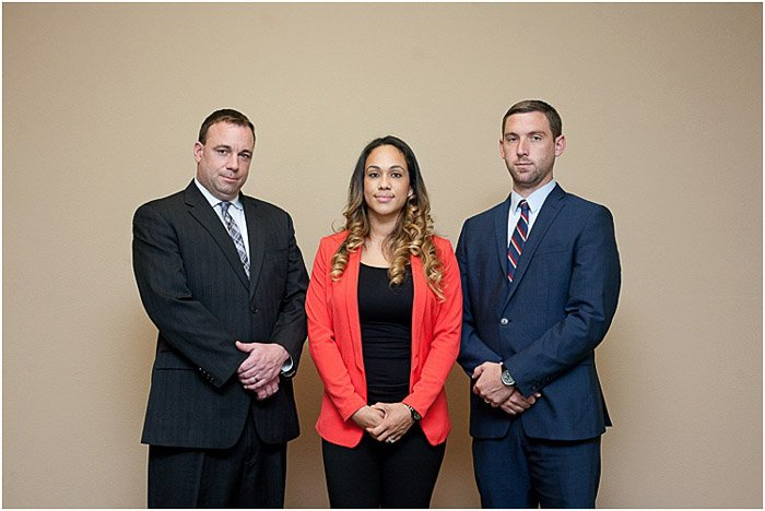 Three people posing for a formal portrait