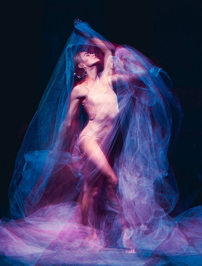Fine art photography of a dance of beautiful ballerina.