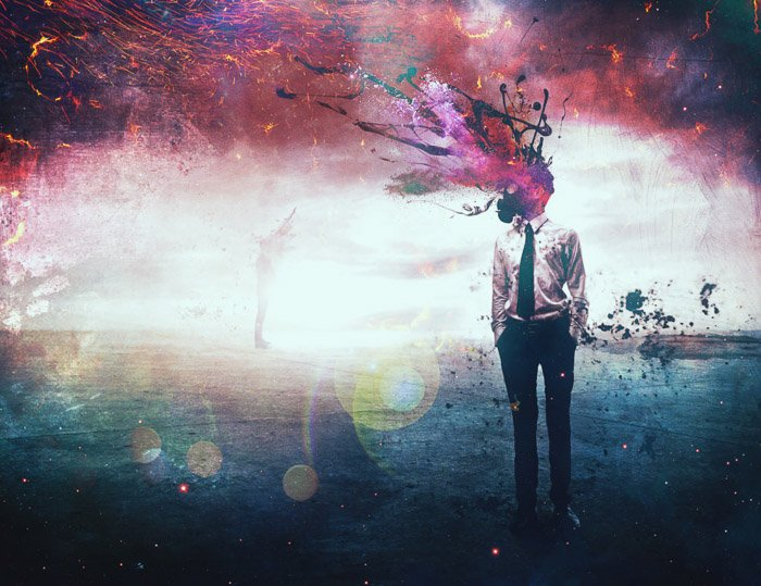 A colorful surreal portrait of a male model with exploding colors for a head