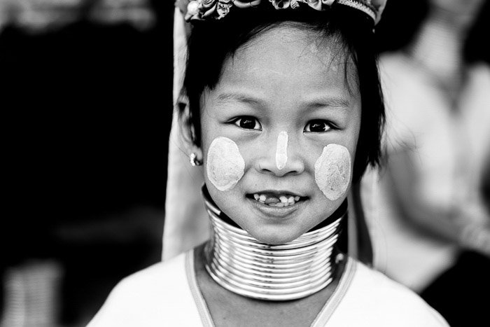 A close up portrait of a young Kayaw Girl in traditional dress and face paint - shallow vs deep depth of field