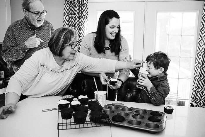 Monochrome shot of a family group posing for a family portrait indoors