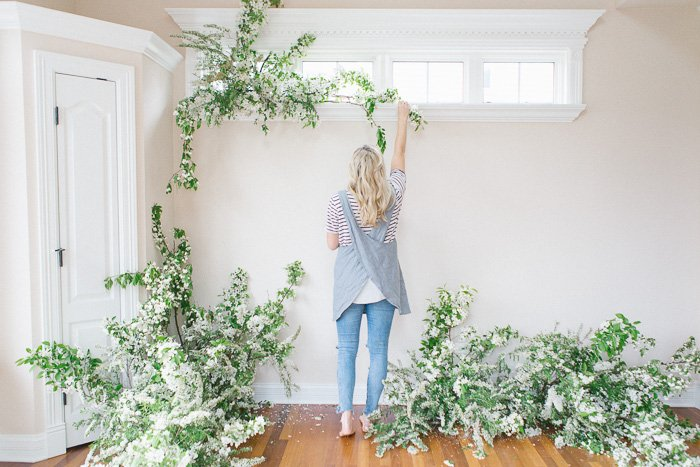 A photographer decorating their home photography studio