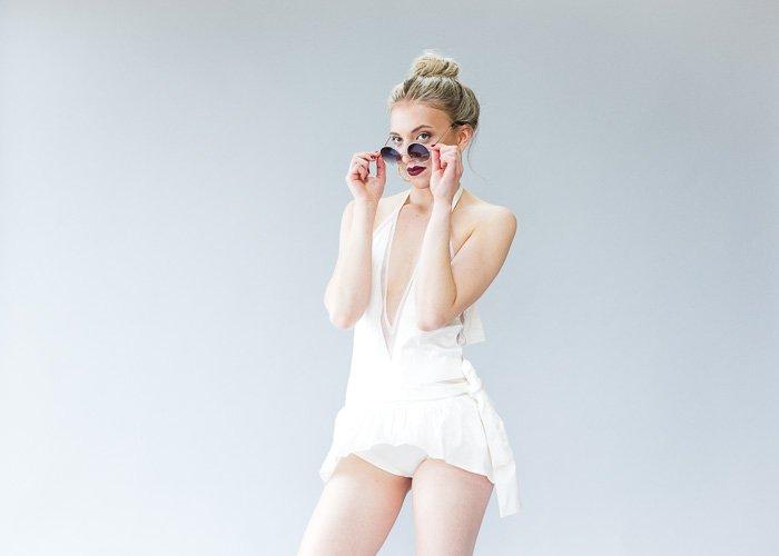 A female model posing in a studio - photography studio equipment
