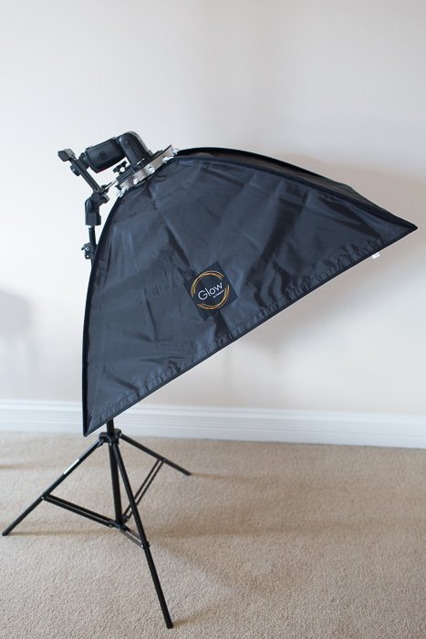 A basic portable softbox with just an external flash trigged from off-camera setup.
