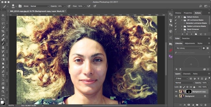 Editing an overhead portrait of a female model with curly brown hair for soft focus effect