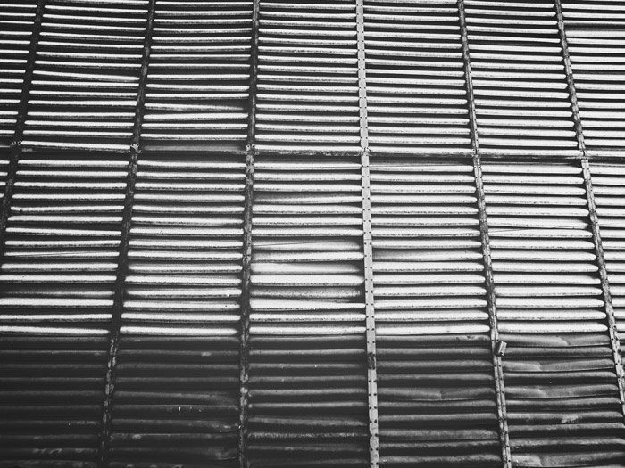 A black and white abstract image of a wooden structure - good abstract photography