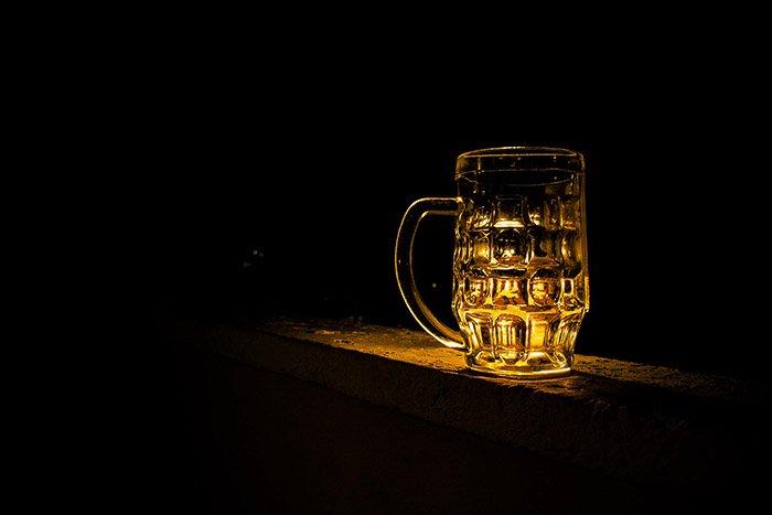 Beer photography shot against black background