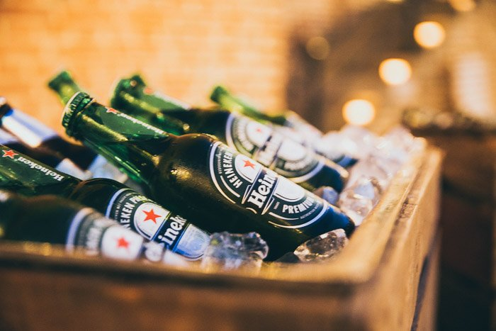A crate of heineken bottles in ice - how to take beer pictures