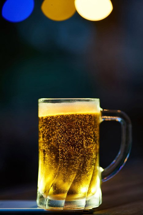 A product photography shot of a pint of beer