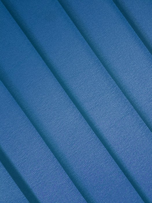 An abstract composition of sheets of blue colored paper - creative abstract photos ideas