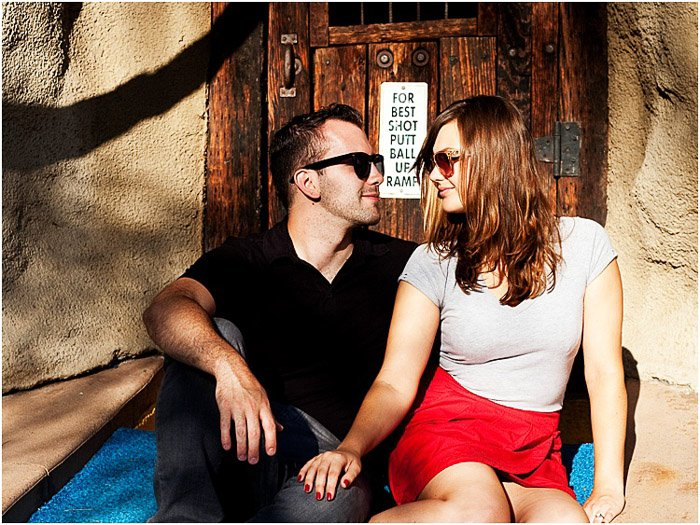 A couple posing outdoors in dappled light