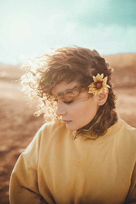 Dreamy photography shot of a female model posing outdoors on the beach - ethereal portraits