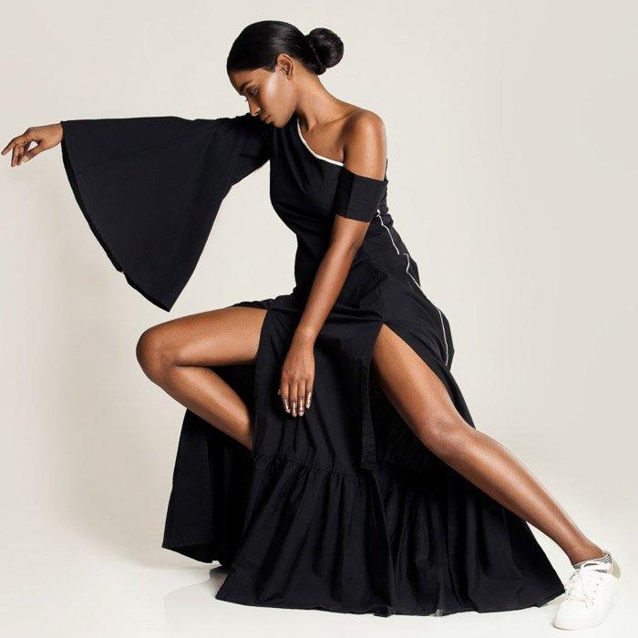 A High Fashion shot of a femal model in black dress - fashion photography types