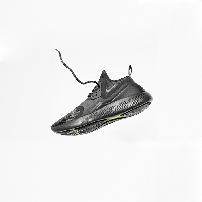 A commercial shot of a black trainer