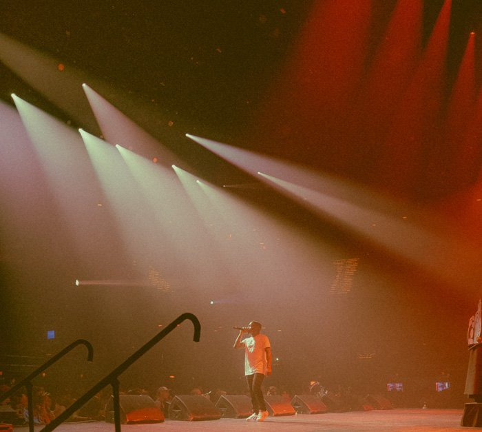 A grainy concert photography shot of a performer onstage - how to fix bad photos