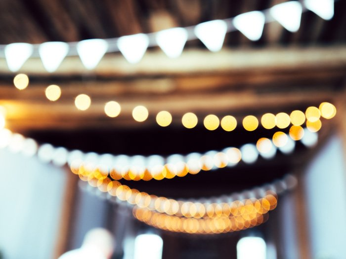 A blurry photo of stings of lights hanging from a ceiling - fix bad photos tips