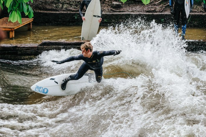 A portrait of a surfer catching a wave - photography tips for fixing bad photos