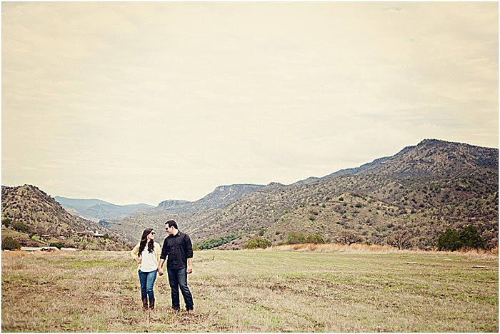 A romantic portrait of a couple posing outdoors - emotional photography