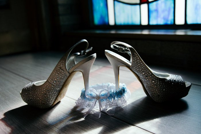 A still life of sparkly shoes takin with hard light photography