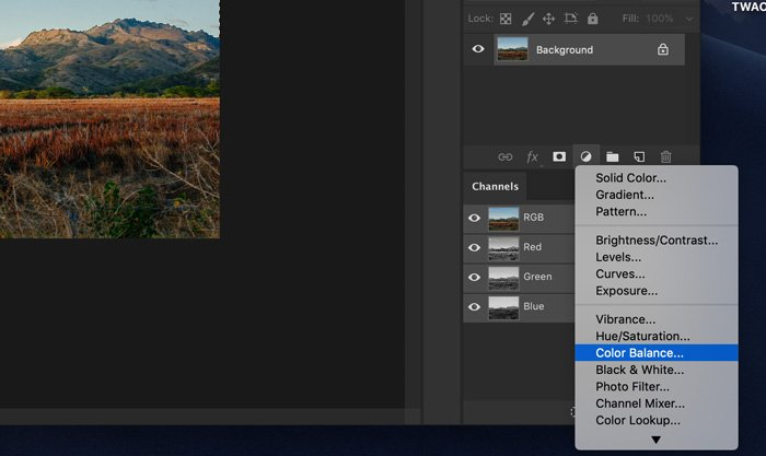 A screenshot showing how to use color balance to change color of the sky in Photoshop