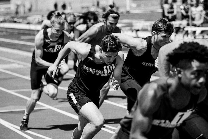 Black and white action shot of professional runners in a race