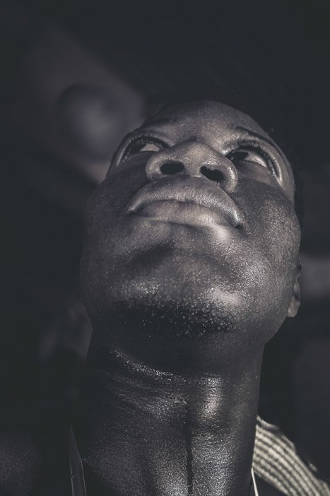 Atmospheric monotone portrait of a man taking from a low angle