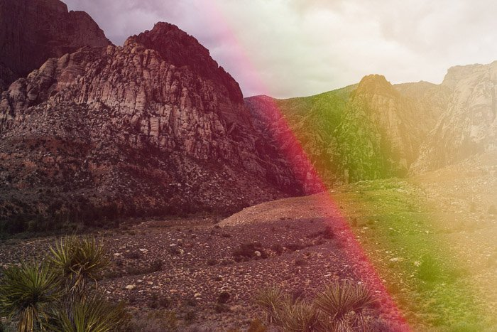 A photo of a rocky landscape with creative light leak overlays