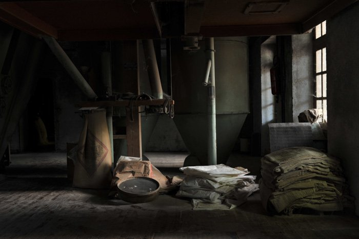 Atmospheric photo of a dark interior of an industrial building shot using manual focus