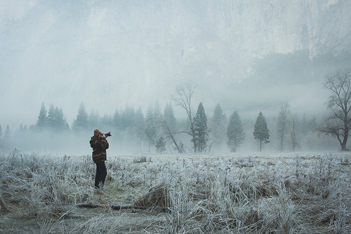 A photographer shooting in a magical winter landscape