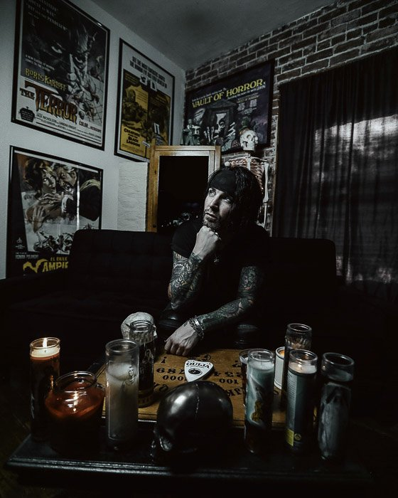 Dark and moody portrait of a man in an interior setting - types of photography lights