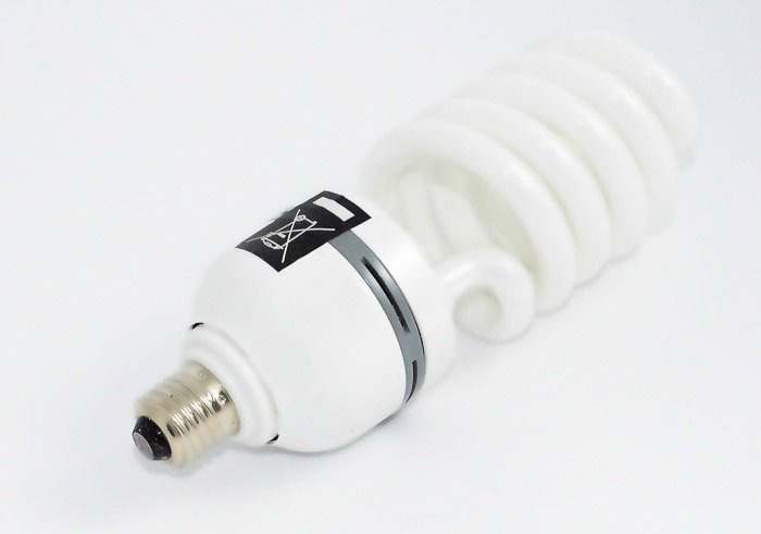 A fluorescent light bulb on white background - types of lights