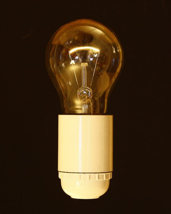 A Tungsten Light bulb against black background - types of studio lights