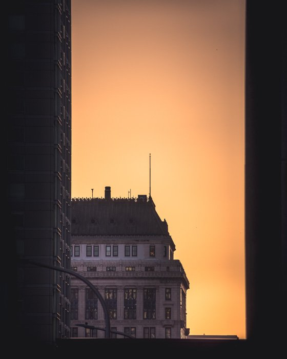 A building famed by other buildings at sunset