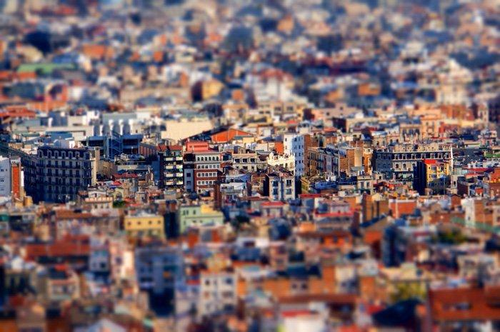 An overhead shot of a sprawling cityscape shot with a tilt shift lens