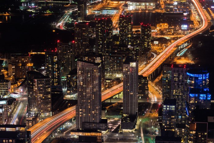 An aerial view of a sprawling cityscape at night