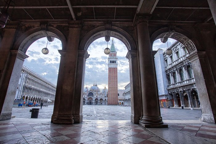 The Piazza San Marco shot through stone arches - Venice pictures