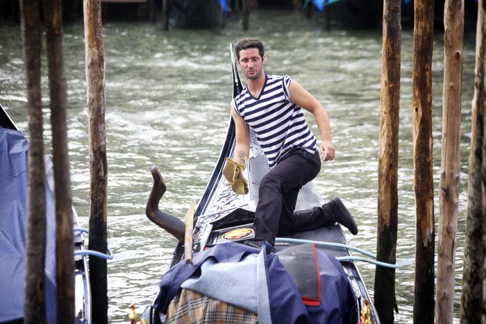 A gondolier along the grand canal in Venice. Venice photography tips