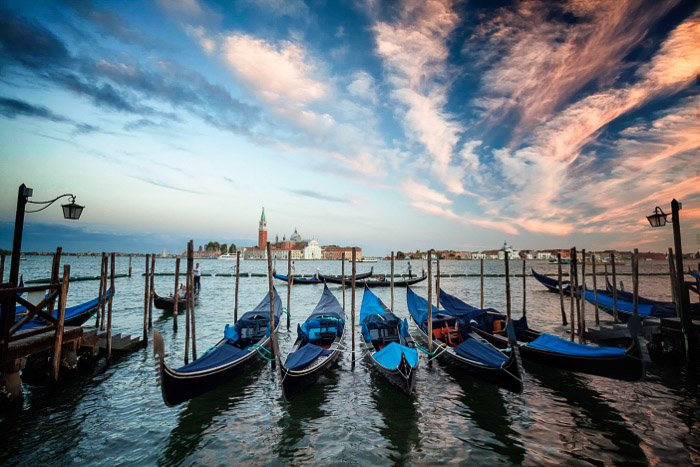 One of the classic Italy pictures are the lines of gondola's in Venice.